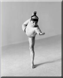 Bikram Choudhury doing Standing Bow Pulling Pose